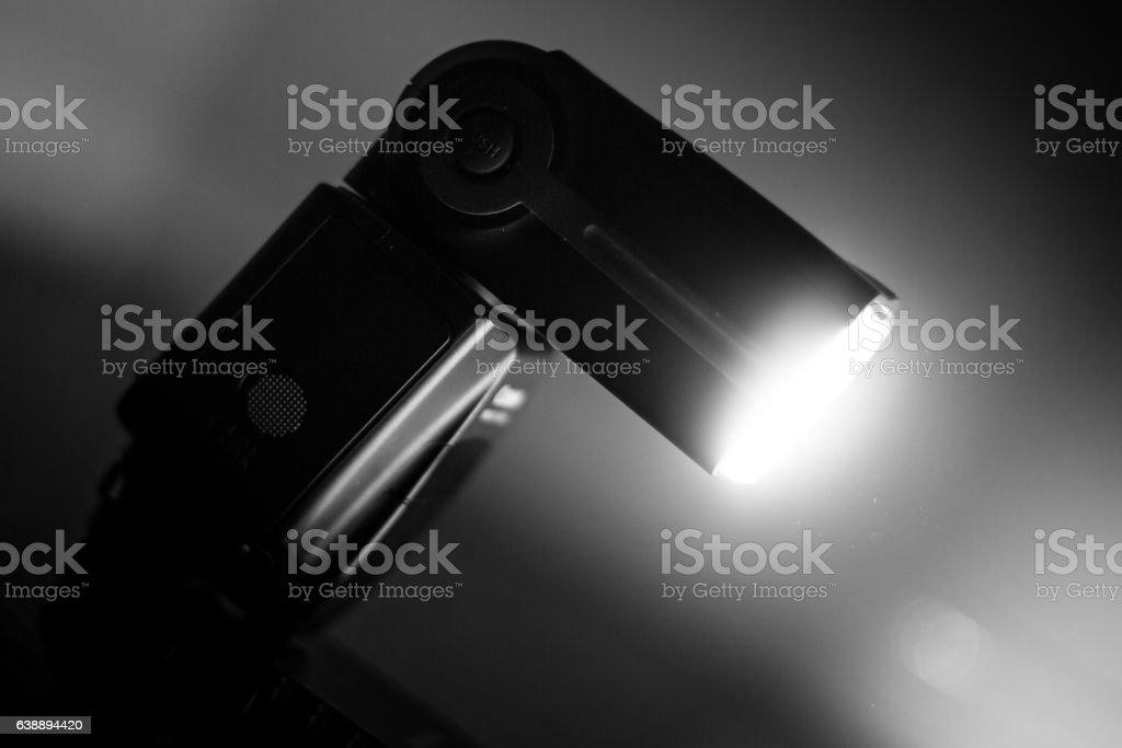 Firing speedlight test stock photo
