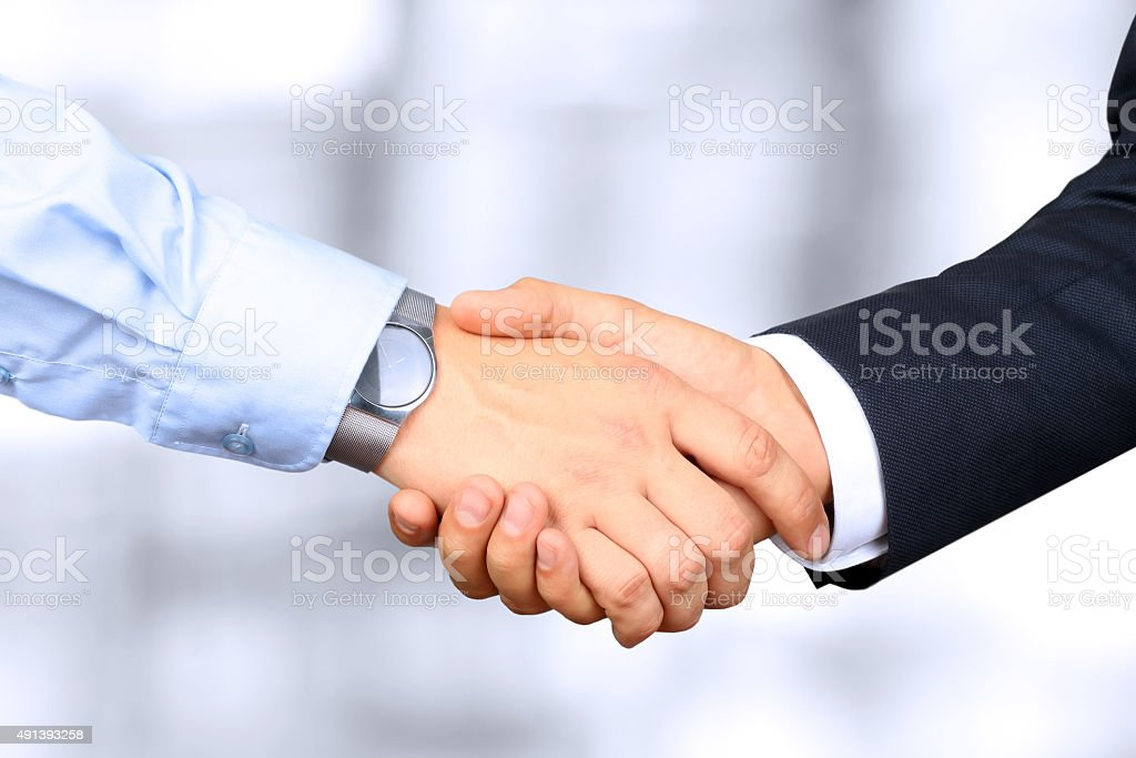 Firm handshake between two colleagues stock photo