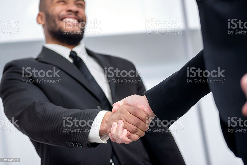 firm handshake. Two successful smiling businessmen shaking hands stock photo