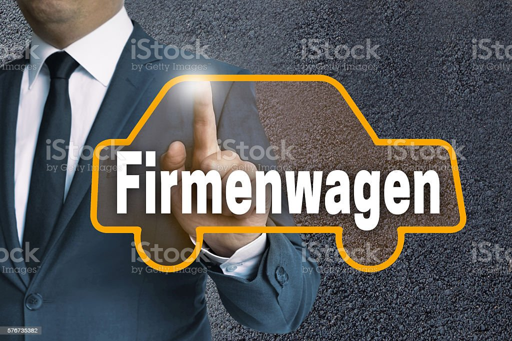 Firmenwagen (in german Company car) auto touchscreen is operated stock photo