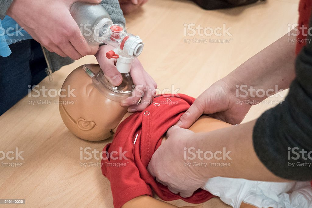 First aid - baby CPR training stock photo
