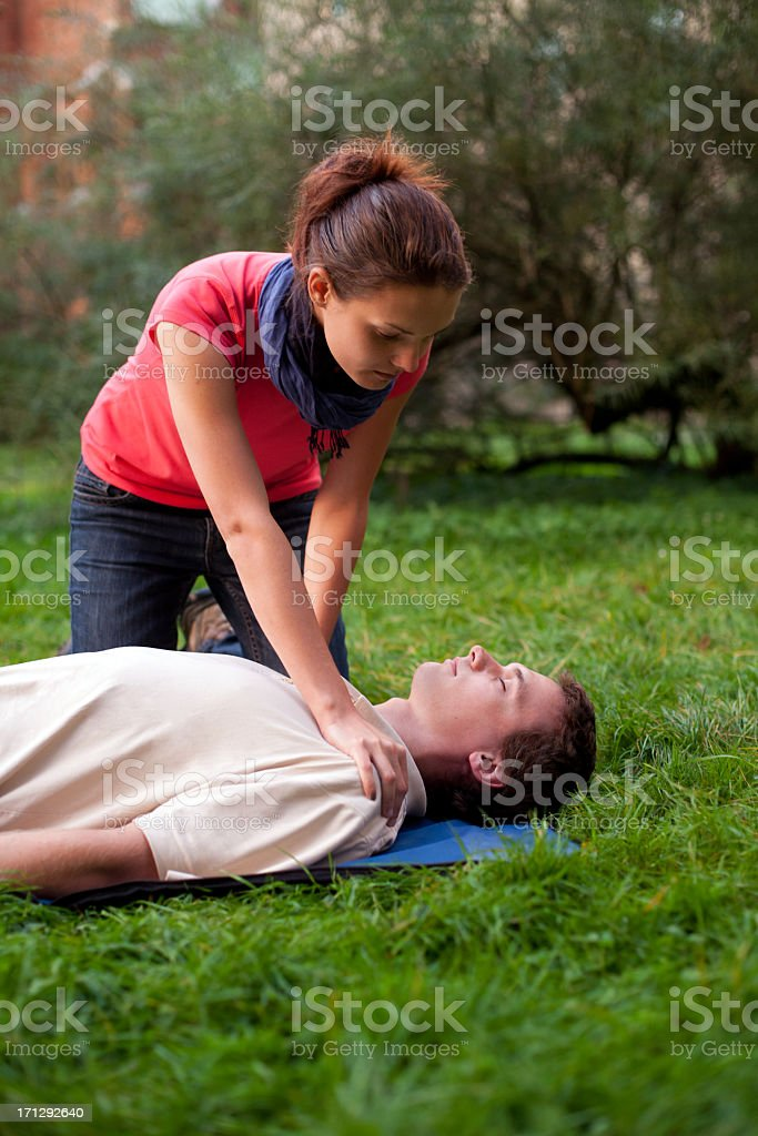 First aid - check consciousness stock photo