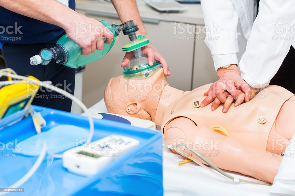 First aid CPR seminar,mechanical ventilation of dummy stock photo