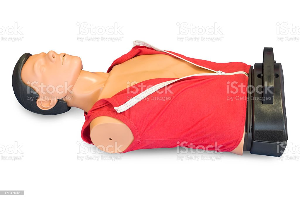 First aid dummy, isolated on white background stock photo