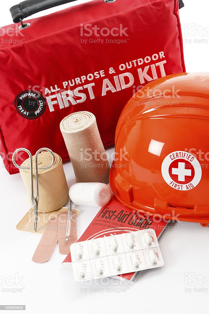 First aid kit with bandages and hardhat stock photo