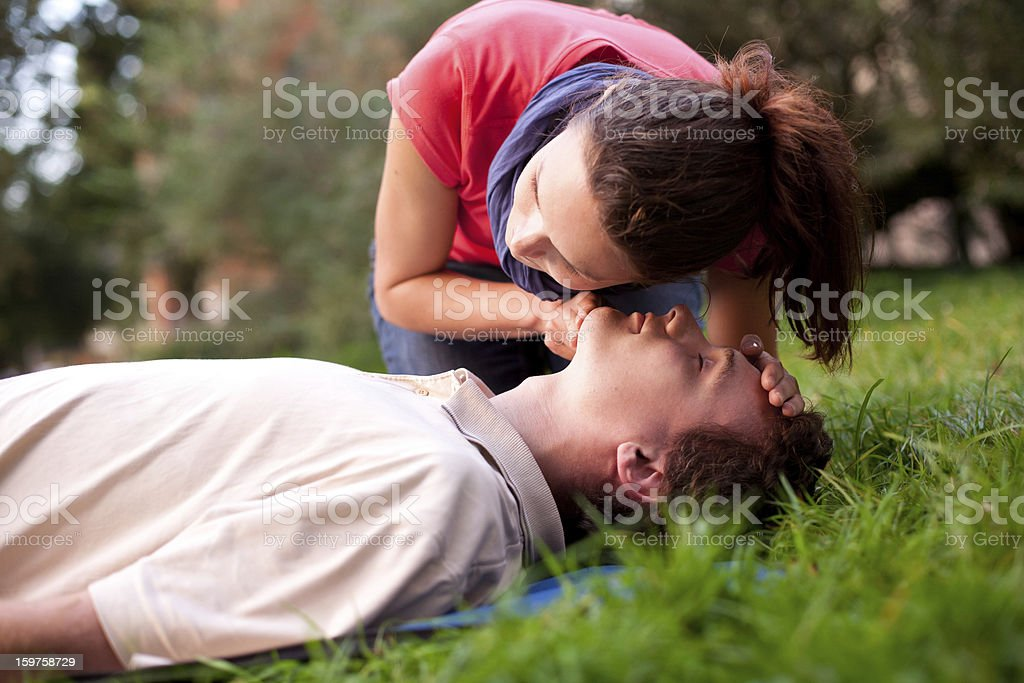First aid - Look, listen and feel for breathing. stock photo