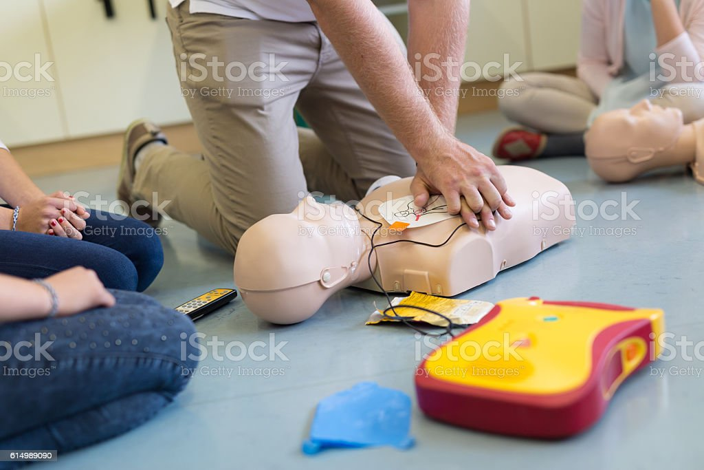 First aid resuscitation course using AED. stock photo
