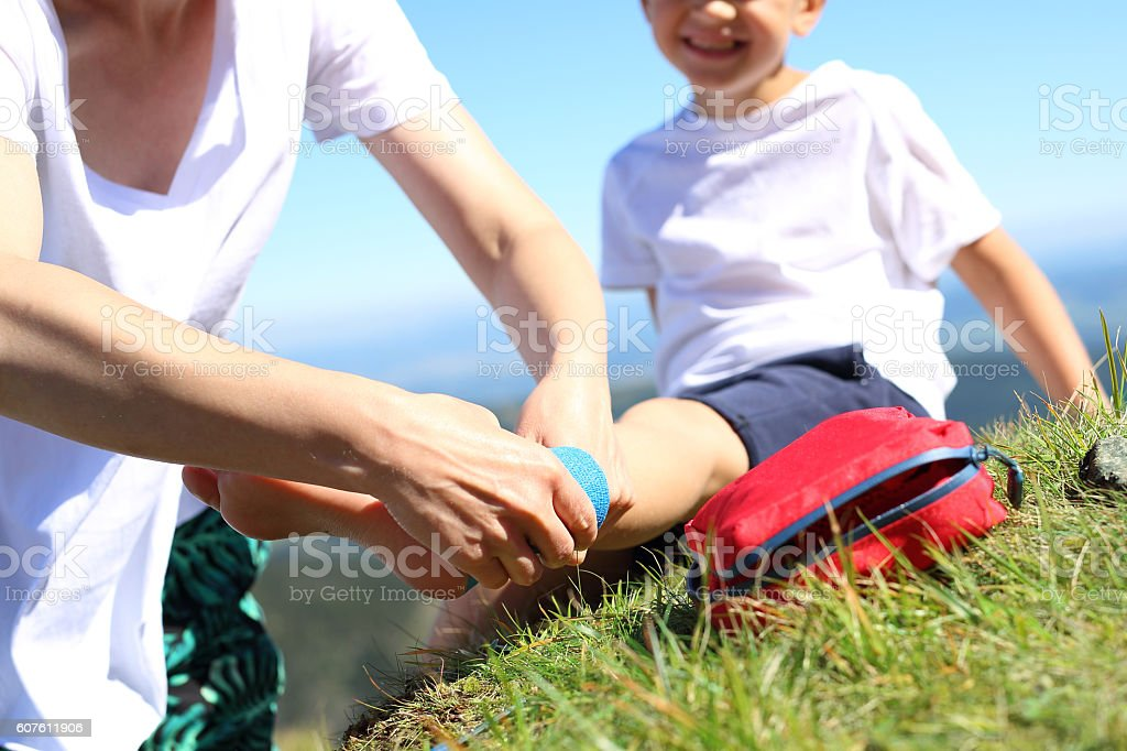 First aid, twisted leg. stock photo