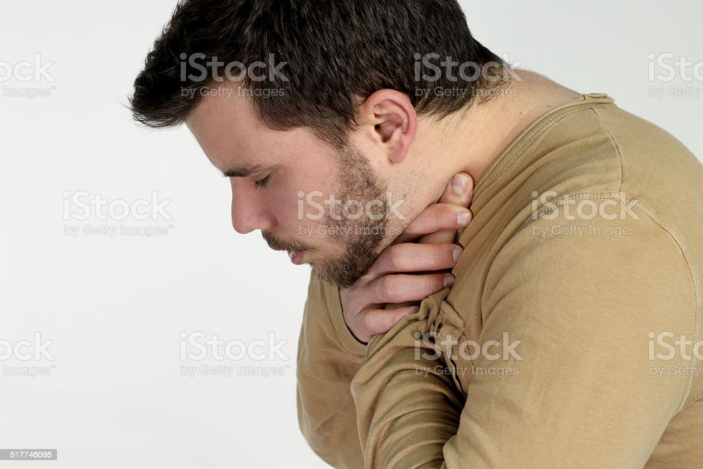 first aid - young man choking stock photo