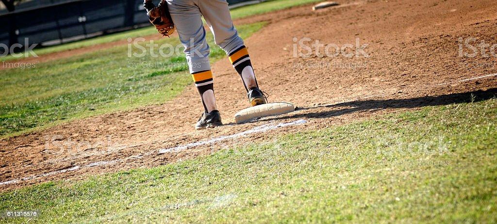 First Baseman On Baseball Diamond Playing Field stock photo