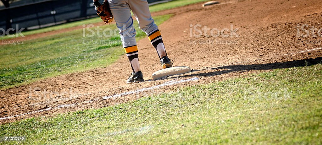 First Baseman On Baseball Diamond Playing Field stock photo