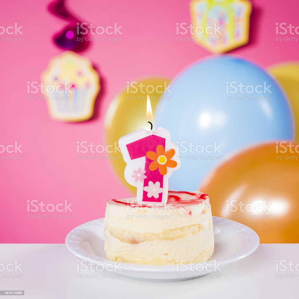 First Birthday, birthday cake with one candle on table, pink royalty-free stock photo