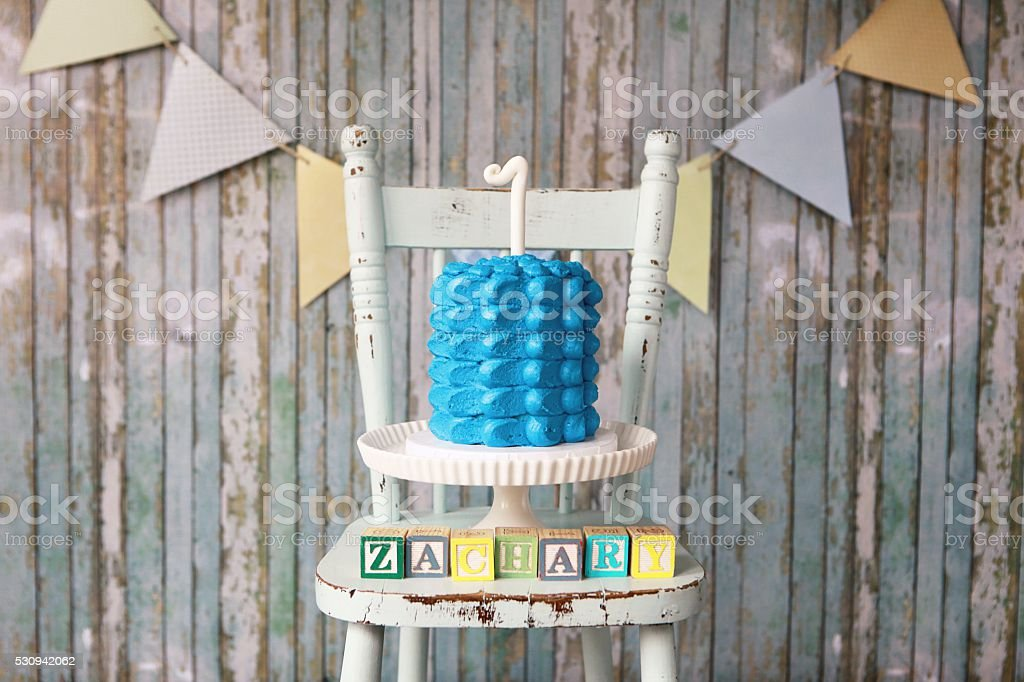 First Birthday Cake with Boy's Name Spelled in Toy Blocks stock photo