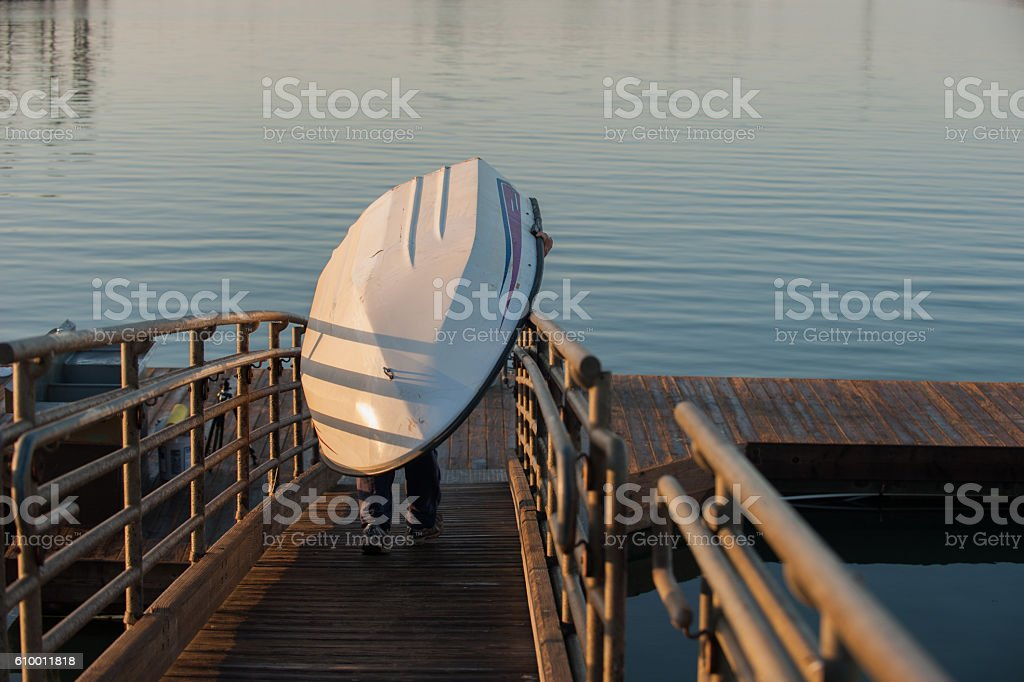 First boat to the marina docks at dawn. stock photo