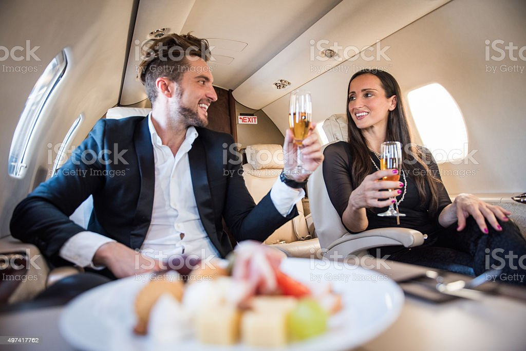 First class meal in private aeroplane stock photo
