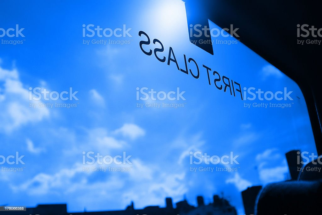 First class sign on glass window of a train carriage stock photo