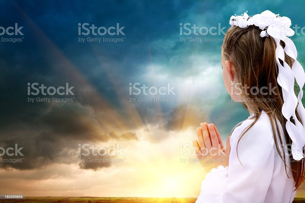 First Communion girl and God royalty-free stock photo