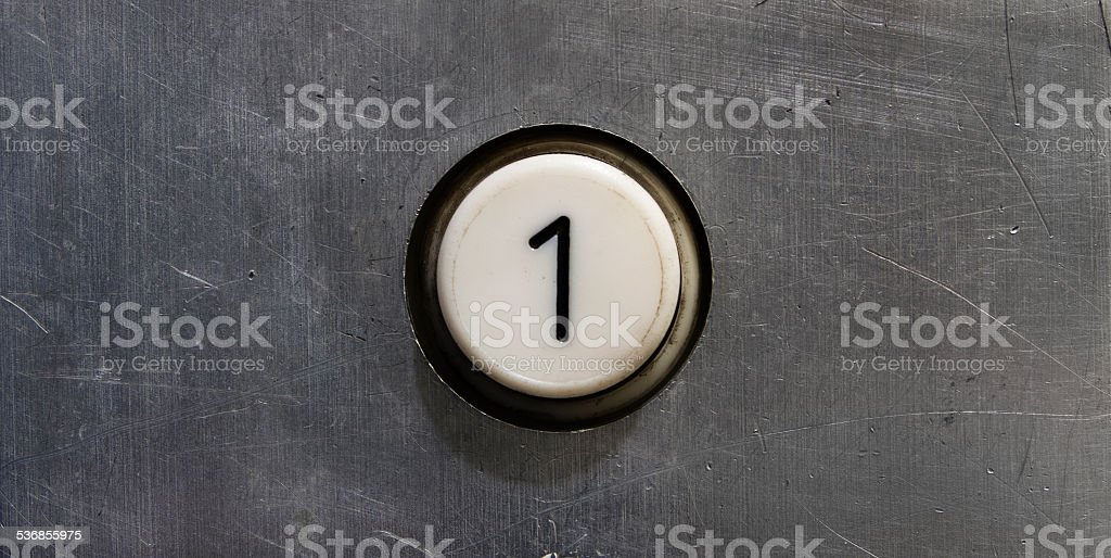 First floor elevator button stock photo