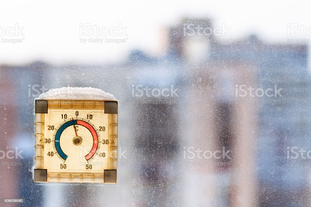 first frost in city - temperature on thermometer stock photo
