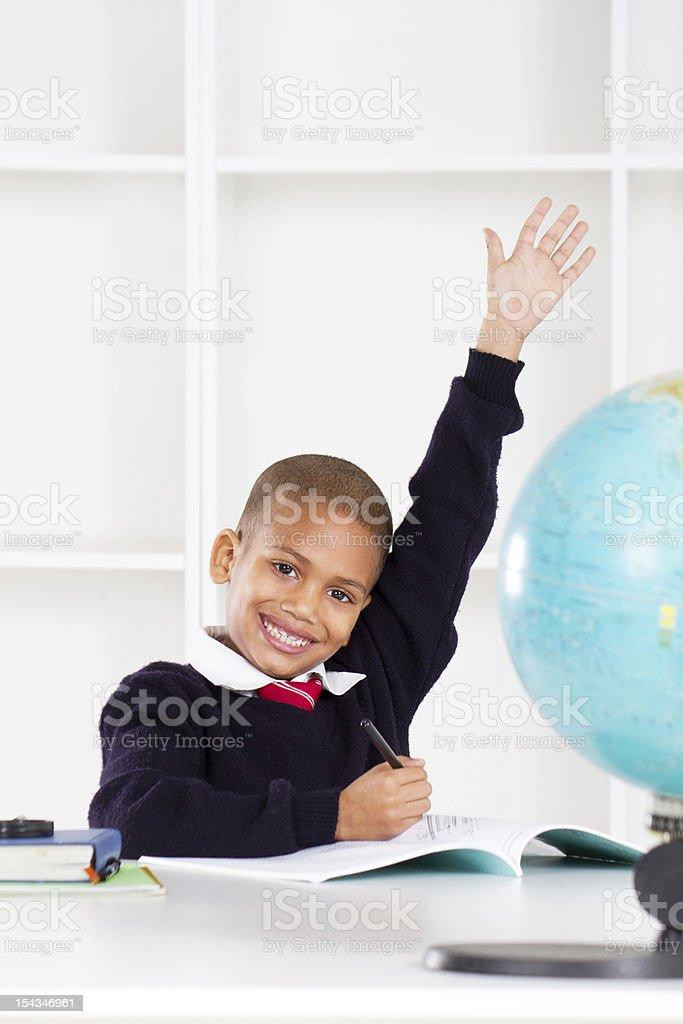 first grade student raising hand royalty-free stock photo