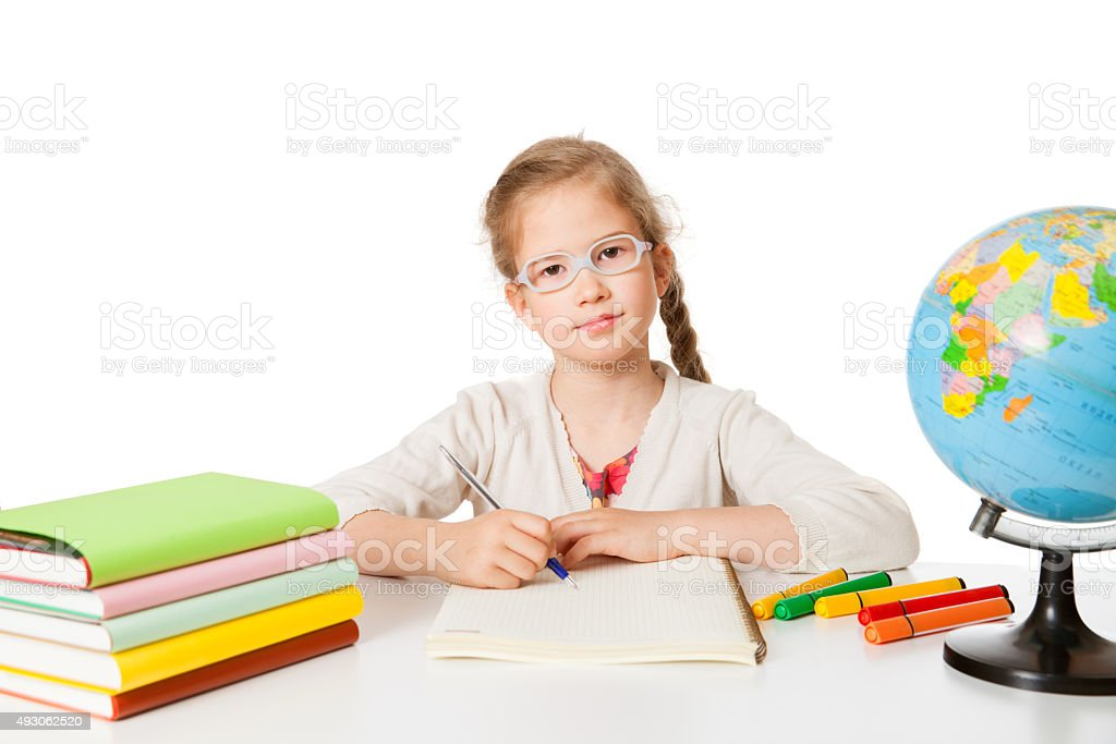 first grader at the school-desk stock photo