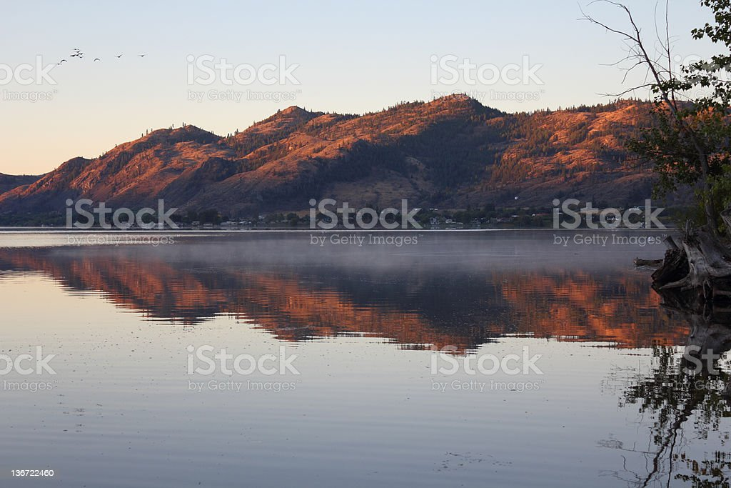 First Light, Morning Mist, Osoyoos Lake stock photo
