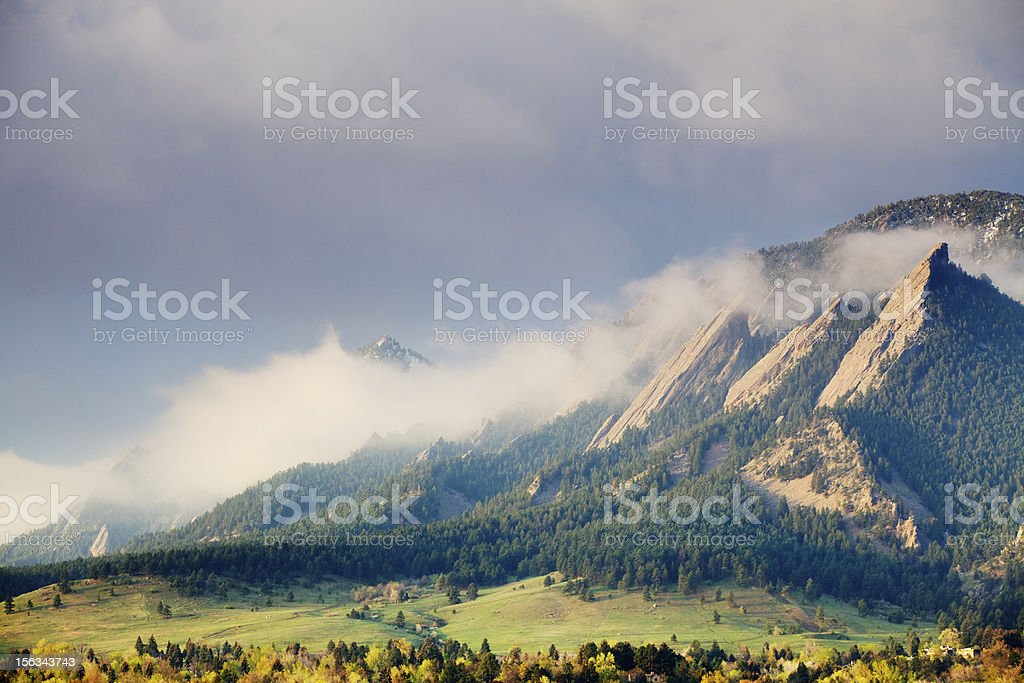 First Light on the Boulder Colorado Flatirons stock photo