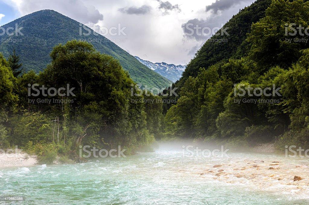 First Morning Sunbeam Soca River Slovenia Europe stock photo