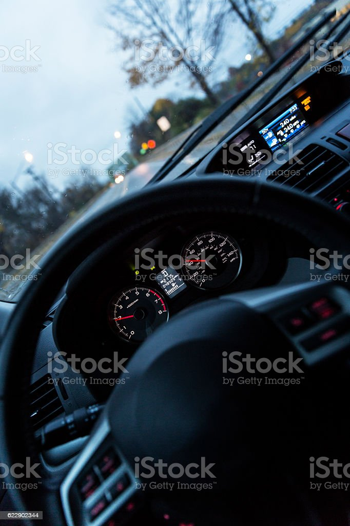 First Person Driver POV Car Steering Wheel and Digital Dashboard stock photo