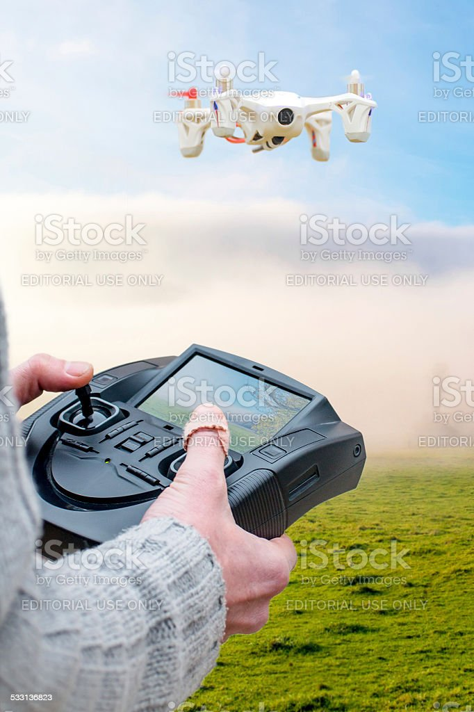 First person view drone flying with remote stock photo