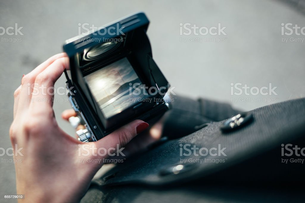 First person view through vintage camera viewfinder stock photo