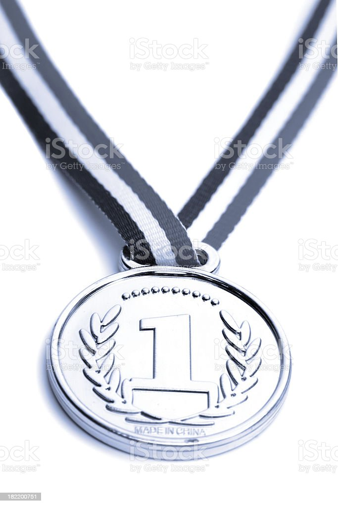 A first place award medal on a white background royalty-free stock photo