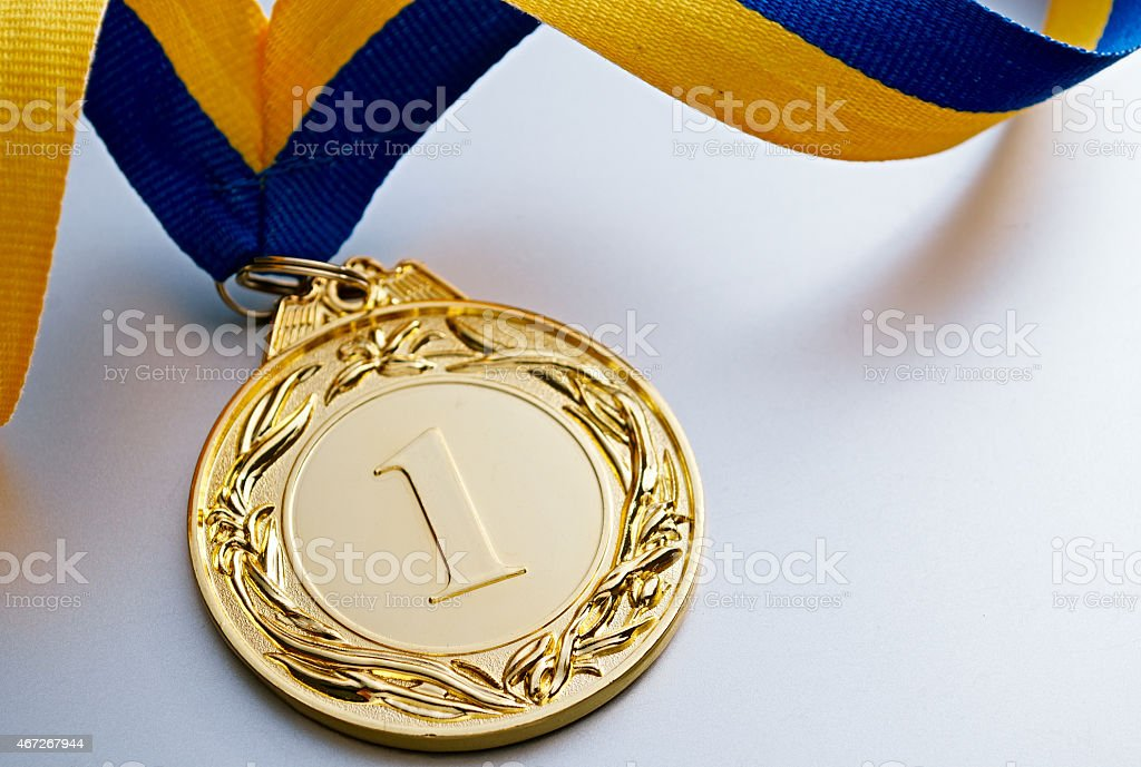 First place gold medal on white background stock photo