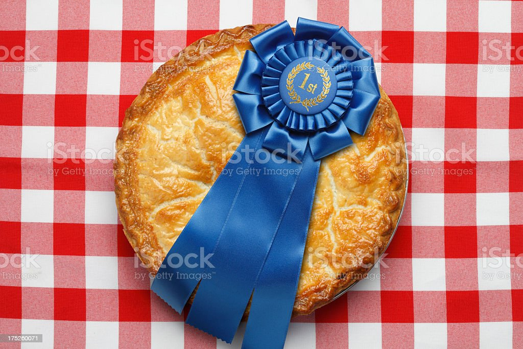First place ribbon on pie sitting on red checkerboard tablecloth stock photo