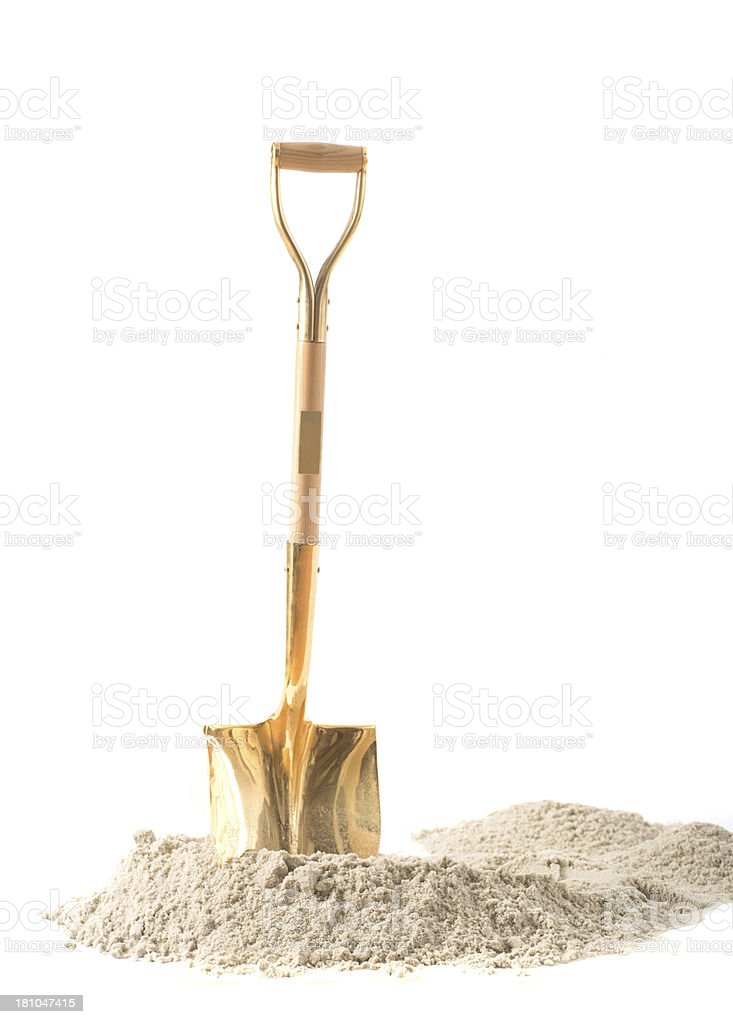 first shovel on heap of sand with white background stock photo