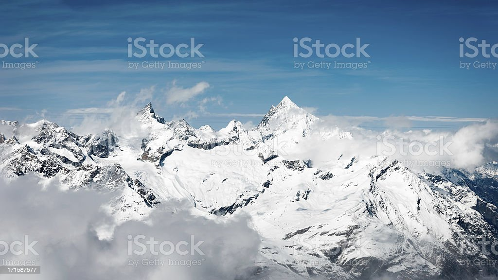 First snow at mountain peaks stock photo