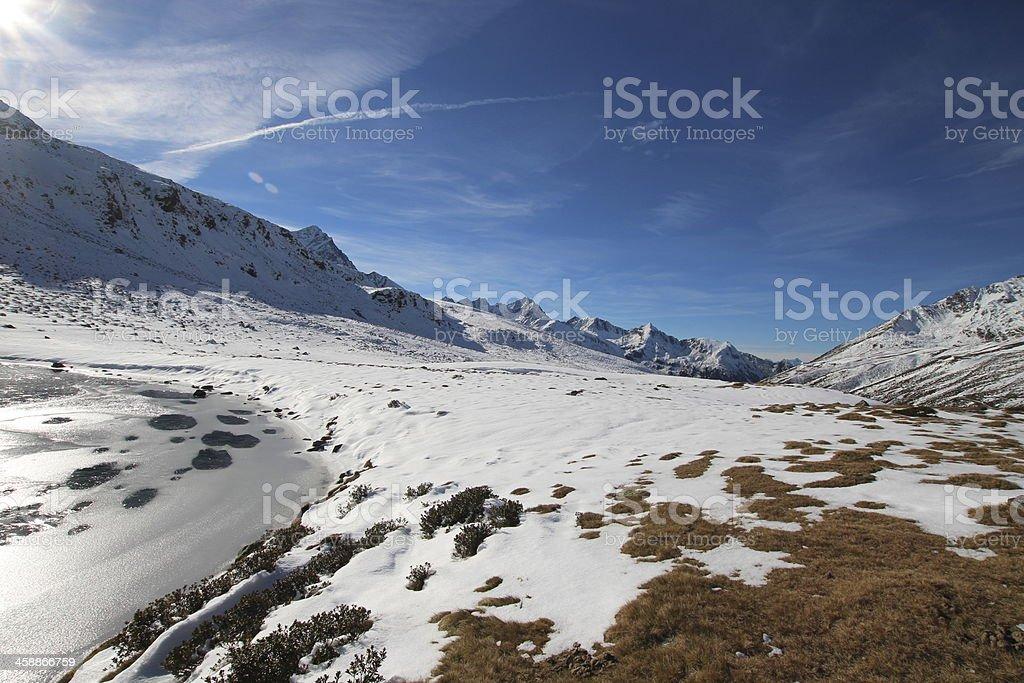 First Snow & Ice in Autumn, Panorama Hirschebensee, Tyrol, Austria stock photo
