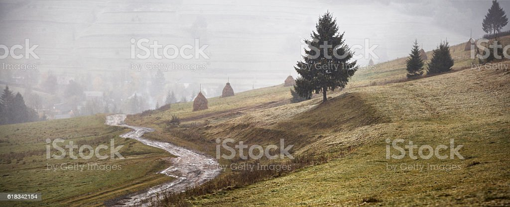 First snow in autumn. Snowfall in mountains stock photo