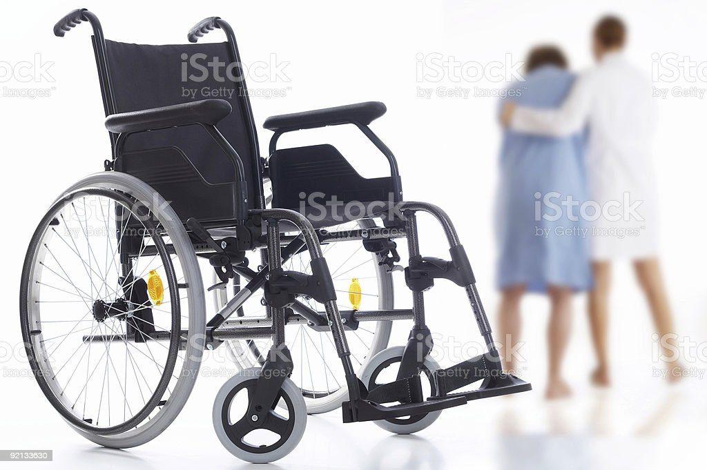 first step nurse helping a patient trying without wheelchair stock photo