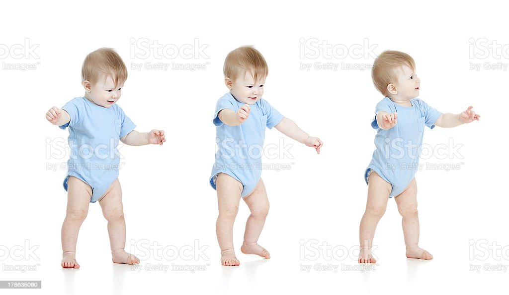 First steps of baby on white background stock photo