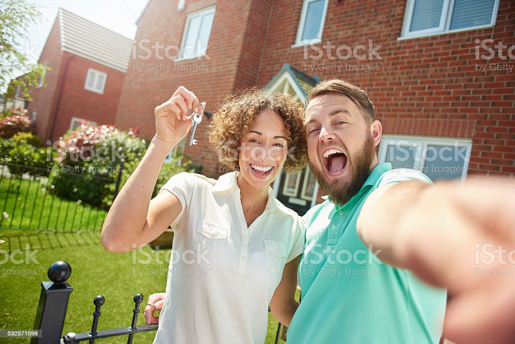 first time buyer selfie stock photo