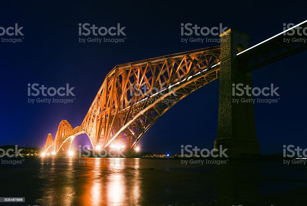 Firth of Forth Rail Bridge illuminated at night stock photo