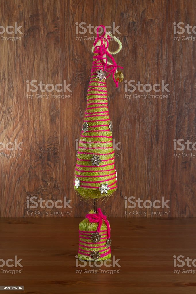 Fir-tree the toy decorated by a rope stock photo