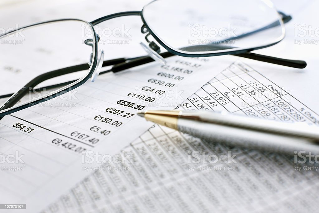 Fiscal Reports and Glasses royalty-free stock photo