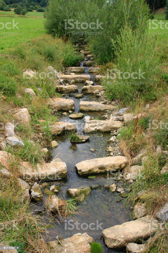 Fischtreppe in einem Flussbett stock photo