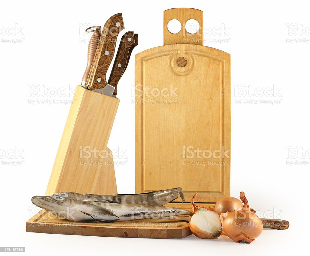 Fish, a board and knifes isolated on white . royalty-free stock photo