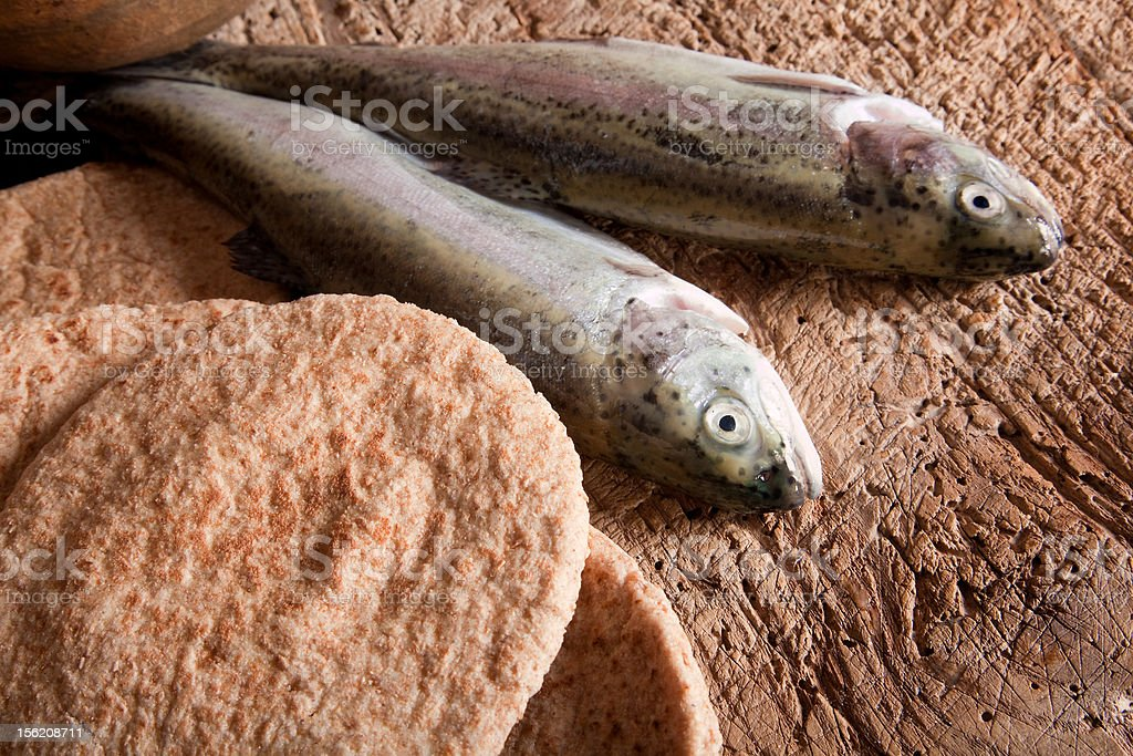 Fish and bread stock photo