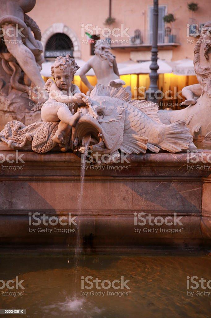 Fish and cherub angel water fountain stock photo