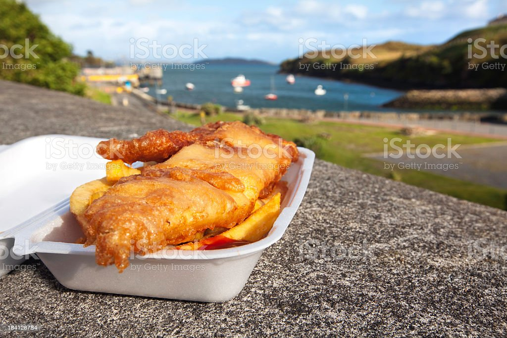 Fish and chips are ready to eat outdoors stock photo