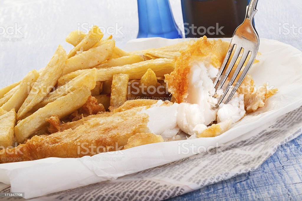 Fish and chips in newspaper stock photo